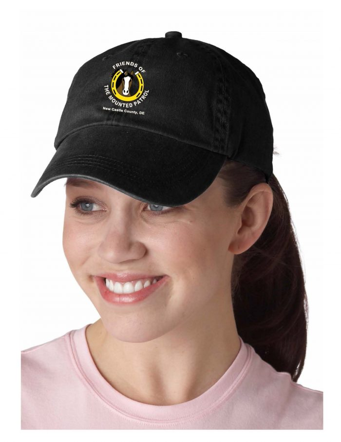 Photo of woman wearing black baseball cap with FMP logo