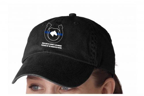 "Photo of model wearing black baseball hat with ""blue line"" logo"