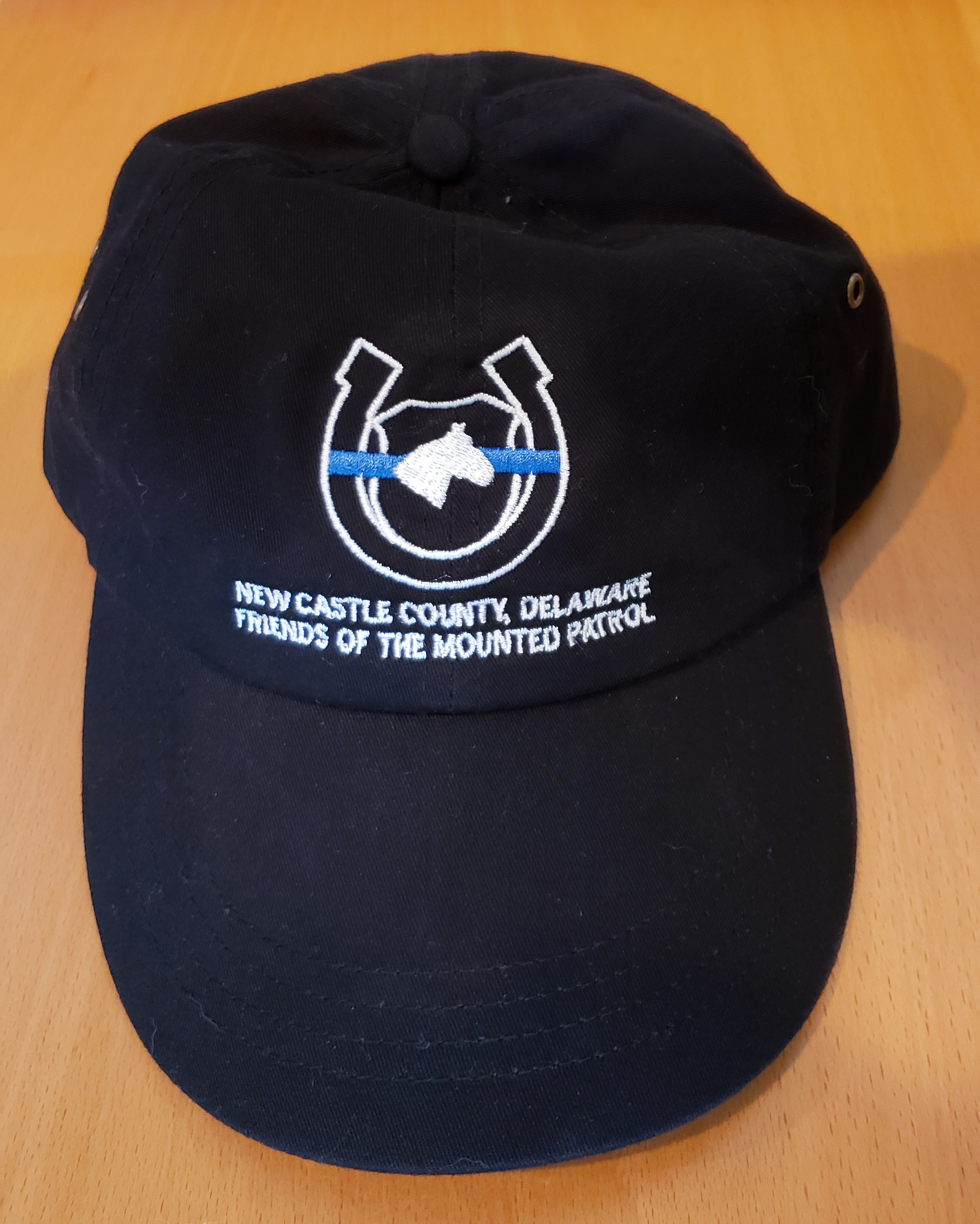 "FMP black hat showing ""Blue Line"" logo"